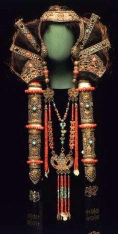 Headdress and necklaces once worn by a married woman of the Chalcha, a Mongolian subgroup, ca.19th century. Gilt bronze, coral, turquoise, pearls, and silk