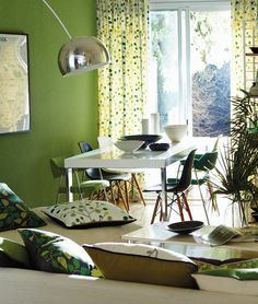 A contemporary green dining area featuring fabrics and wallpapers from Scion's Melinki collection.