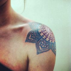 Mandala shoulder tattoo. I love the colors and flowery petals
