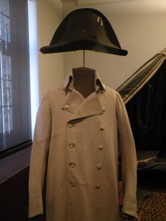 Napoleon's hat and coat and behind him is his campaign bed - Musee des invailde in Paris. Amazing museum.