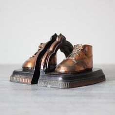 Bronzed baby shoes. When I was a kid these used to freak me out now I like them.