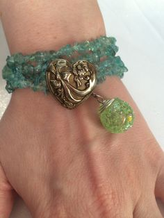 Green kyanite in a double strand wrap bracelet. It has a heart button closing and a marble charm. It can also be used as a necklace. Heart Button, Cuff Bracelets, Handmade Jewelry, Charmed, Green, Fashion, Moda, La Mode, Fasion