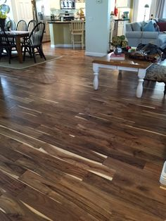 "Raving Fan for customer-favorite Tobacco Road Acacia! ""We love our new floors! The light and dark color variation matches nicely with our furniture. The feel underfoot is warm and cozy, and perfect with a rug in living room area. This floor sweeps up easily and cleans well with the recommended cleaning products. This is exactly the floor we've been looking for!"""