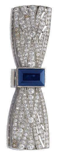 An Art Deco sapphire and diamond brooch, Boucheron, 1920s. The brooch of bow design, pierced and millegrain-set with a step-cut sapphire, circular-, single-cut and rose diamonds, signed Boucheron, Paris, French assay marks. #ArtDeco #Boucheron #brooch