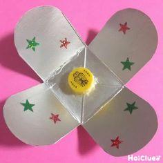 牛乳パックのくるくるコマ〜乳児さんから楽しめる手作りおもちゃ〜 | あそびのタネNo.1[ほいくる]保育や子育てに繋がる遊び情報サイト