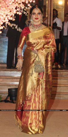 Actress Rekha, dressed in her usual kanjivaram sari, glittered at the do.