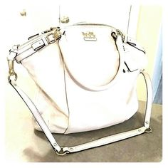 "🌟MAKE AN OFFER Authentic Cream Coach Handbag Buttery feel soft leather purse.  Clean interior with front zip closure pocket.  Gold accents.  Dust bag and longer strap included. Size: Approximately 14x16.  14"" height 16 "" width.  There is regular wear on the bag and handles due to genuine leather but has been stored well for its color. Large size. The inside has 1 zipped compartment and 2 open compartments. One handle has a snag as shown in pic 4 and the lower back part of the bag has two…"