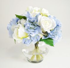 Features:  -Glass cup vase.  -Faux silk blue hydrangew and white rose.  -Acrylic water.  Country of Manufacture: -United States.  Product Type: -Floral Arrangements/Centerpieces/Flowers.  Color: -Blue