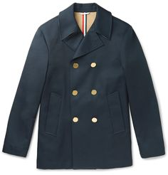 <a href='http://www.mrporter.com/mens/Designers/Thom_Browne'>Thom Browne</a>'s classic navy peacoat has been crafted in Italy from cotton-gabardine that provides structure and guarantees its longevity. The anchor-embossed gold buttons add to its nautical feel, while internal taped seams will keep chilly breezes at bay. Wear it with nearly anything in your smart-casual wardrobe.