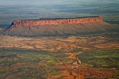 Mt Connor - a Mesa 700 million years old. Mt Connor lies in a direct line  with NT 's 2 other large attractions Uluru and Kata Tjuta althoough it is older x 2-300million yrs!!  It is part of the Curtain Springs cattle property in the Northern territory, Australia.