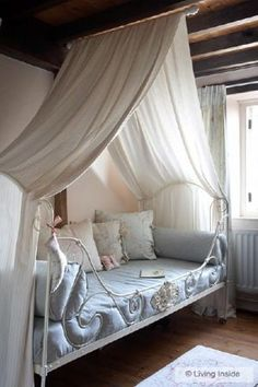 I like this. Center a rod attached to the ceiling and aligned with the middle of the mattress. Hang and drape a measurably long length of fabric into a canopy. It gives a tent effect. Kids love that. Plus, you can add and remove on a whim.