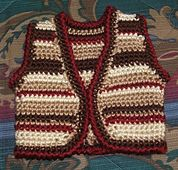 Ravelry: L'il Saddle Tramp Vest pattern by Carol Ballard - Free Pattern. Goes great with the Chaps pattern found on the Cobbler's Cabin website (also free pattern) and the Cowboy Boots by Michael Sellick. All these pattern links are on my board.