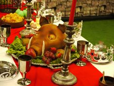 A very creative Medieval feast for kids with blackbird pies, pig head cake, pear shaped cupcakes