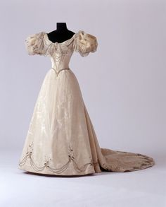 Wedding dress of Princess Alexandra of Saxe-Coburg and Gotha (a granddaughter of Queen Victoria), by Madame Maynier, London, 1896. Silk moiré, taffeta, silk chiffon, silk and metal embroidery, glass beads. Photo: H. Zwietasch / Württemberg State Museum, Stuttgart.