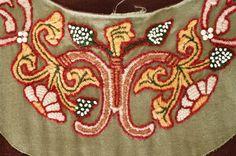 http://broiderers.lochac.sca.org/Gwir_12thc_collar.jpg - 12thC woolwork collar.