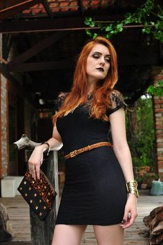 black dress - street style - animal print - clutch spikes