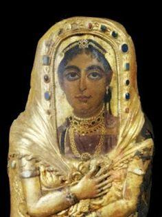 A Fayum portrait still affixed to its jewel-encrusted mummy case.