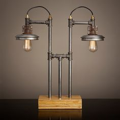 """Iron pipe lamp"" Surely one of the best pieces of industrial art I have seen in a long time. The use of materials is not overly complicated or cluttered, just very clever. Not only a recommendation to my clients but I would also happily have this in my own home. - Jayde Deverson - Garage Mahal International"
