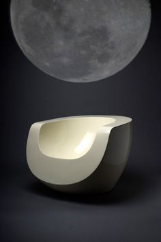 nicethingsbycoolpeople:  Is it weird if I want to run my hands all over this chair?  It is?  Sorry.   This lovely object is the Moon Chair by Mike To.  I reminds me of Eero Aarnio's shiny hollow plastic chairs but the sharp edges make it very modern and definitely not a blobject.