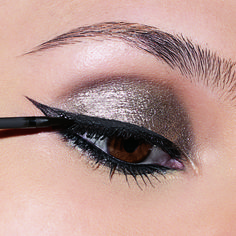 silver eye shadow and a bold cat eye