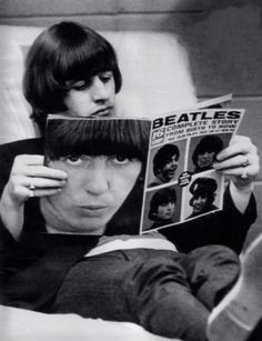Looking at a Beatles magazine.