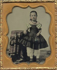 1850-60 Little girl with bloomers and a tiny purse