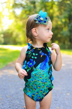 6202835d810 Your little lady will be a jaw dropper in this stunning Peacock Romper!  Find it at  www.etsy.com shop littlelakethreads