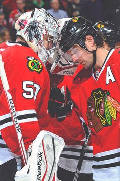 Patrick Sharp and Corey Crawford share a moment after Crawford's first win since returning from injury. (January 17, 2014).