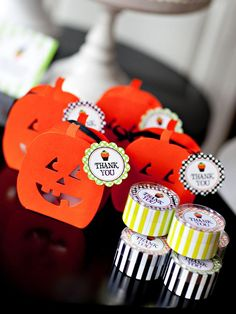 Favor Boxes    Small pumpkin boxes filled with candy are a perfect favor for the guests to take home after the Halloween party. Attach a printable favor tag for the perfect finishing touch.