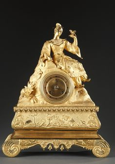 Gilt bronze Romanticism mantel clock. The dial with Roman numerals is surmounted by a graceful Chinese Lady contemplating a bird. The base is decorated with a scene in bas-relief representin