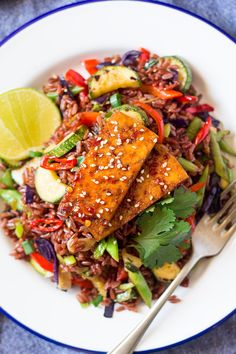Red rice stir-fry with spicy tofu makes a great vegan and gluten-free meal. It's easy to make and any leftovers will make a great cold work lunch too.