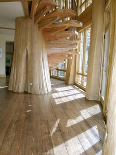 Spiral staircase centered on massive cedar post. Pioneer Log Homes of British Columbia