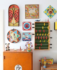 Game boards + kicker table on the wall - Photographed by Natalie Jeffcot via Milk magazine
