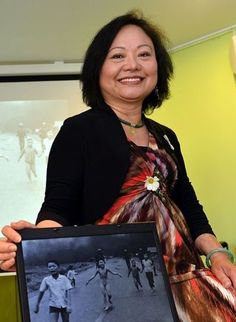 The girl in the photo — naked, crying, burned, running, with other children, away from the smoke — became emblematic of human suffering during the Vietnam War. Kim Phuc was 9, a child who would spend the next 14 months in the hospital & the rest of her life in skin blistered from the napalm that hit her body & burned off her clothes. She ran until she no longer could, & then she fainted. Now married with two sons & living near Toronto, travels the world to talk about the anger she left…