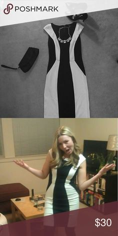 Black and white cocktail dress Flattering black and white dress. Forgiving and comfortable. Worn only once for a night of dancing and general tomfoolery, as evidenced by my silly pic. I wore it in winter with black tights and pumps, but it could be worn any time of year. It might work as a good work dress with a blazer. I listed this as a women's small, it's truly a Juniors 7/8. XOXO Dresses Mini