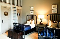 Fun boys' bedroom with twin glossy black abacus beds, cobalt blue ...
