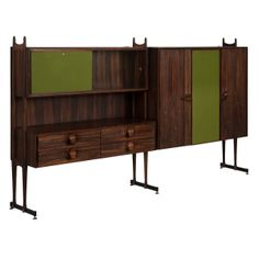 Italian Wall Console in Rosewood for La Permanente Mobilii, 1960's   From a unique collection of antique and modern cabinets at http://www.1stdibs.com/furniture/storage-case-pieces/cabinets/