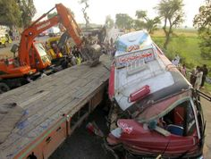 Rescue workers attempting to pull passengers out of a bus after a deadly collision with a trailer truck on Sunday in the Sukkur district of southern Sindh Province-42 were killed including 14 women and 13 children, and left 30 injured. 04/20/2014 Credit Pakistan/Reuters