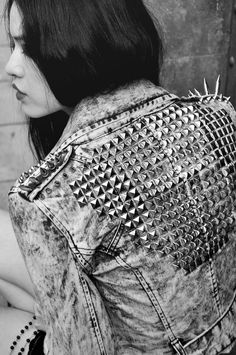 Spiked and studded denim jacket.