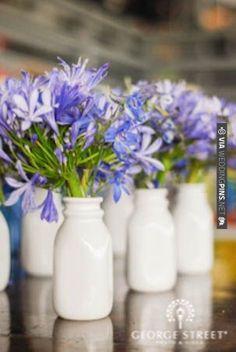 Lovely milk bottle centerpieces!   VIA #WEDDINGPINS.NET