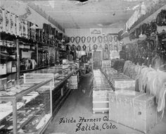Salida Harness Co. Salida, Colo. :: Western History - This is a different view from the other one. The trunks are different and there are no deer heads on the wall.  http://cdm15330.contentdm.oclc.org/cdm/ref/collection/p15330coll22/id/12683
