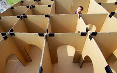 "Cardboard labyrinth. It's as simple to make as it looks; cut doors and windows in pieces of cardboard, then connect these ""walls"" with plastic clips, duct tape or glue in any shape you can imagine and to any size your space permits."