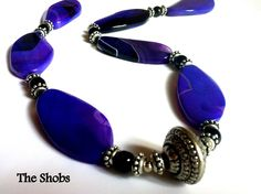 £20 Purple Striped Agate Twisted Ovals Necklace