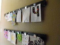 DIY Kids Art Display:  1x8 pine boards  Spray paint  Sandpaper  Large paper clips  Wood glue  Picture hangers