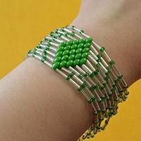 Tutorial on How to Make Bulge Beads Bracelet with Green 2-Hole Seed Beads