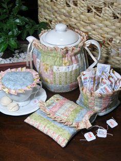 Antique Tea Cozy. Love the mug cover. Need to make some.