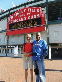 """Laura Rozon sent us this photo of herself and StreetWise Vendor Sam Sanders. She wrote, """"We had the pleasure of meeting [Sam] last week while visiting Wrigley Field. He was very friendly and we were happy to make a small donation to StreetWise. Keep up the good work!"""""""
