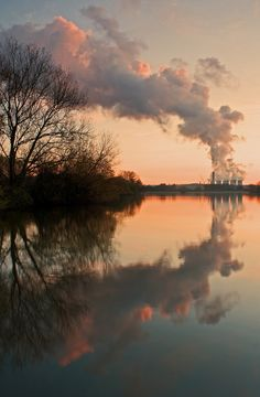 Arch Of Steam - view from the Attenborough Nature Reserve - Ratcliffe-On-Soar Power Station in the River Trent, England, UK