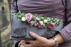 """The Bride's Mum's Hand Bag Corsage of """"Purple Symphony"""" & """"Bombastic"""" Roses and Rolled Metalina Rose Petals, silver Albiflora Brunia and green Skimmia"""