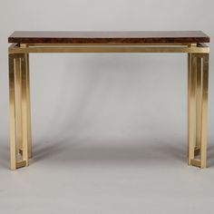 Mid Century Italian Brass and Lacquered Wood Console  --  Circa 1960s Italian console table has a lacquered burl wood table top and open work brass base and legs.  --   Item:  6707  --  Retail Price:   $3895